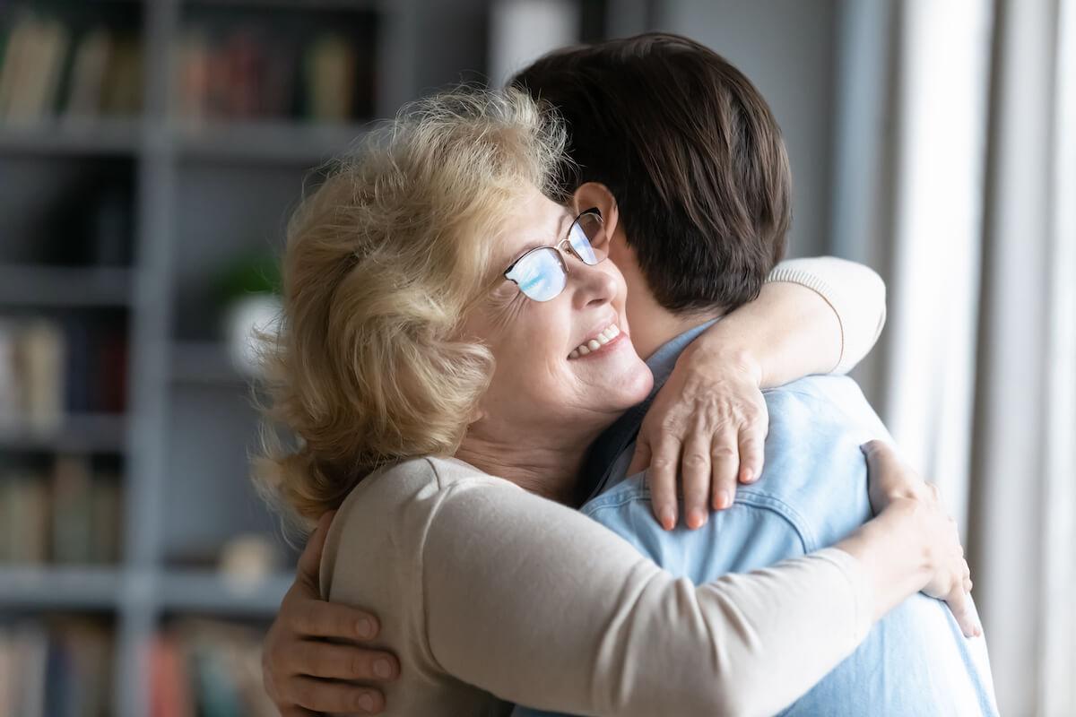 Senior Woman Hugging Family Caregiver