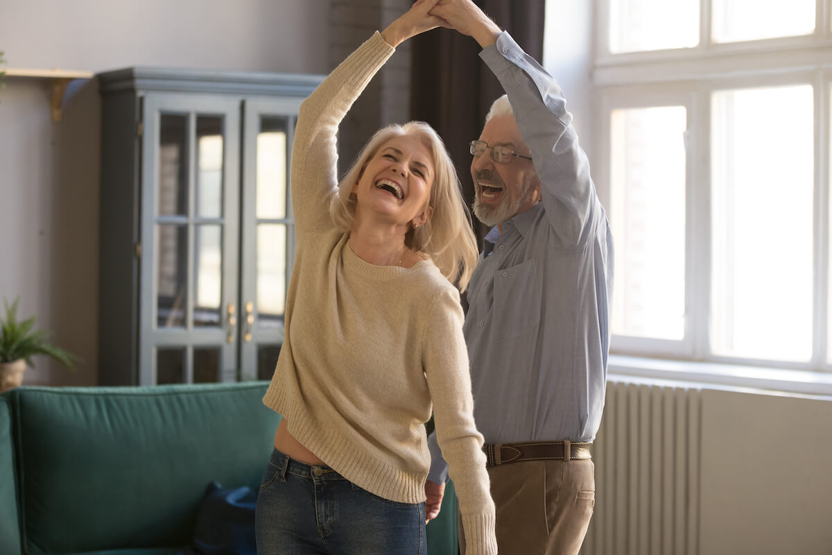senior couple dancing in home_Tips for healthy aging
