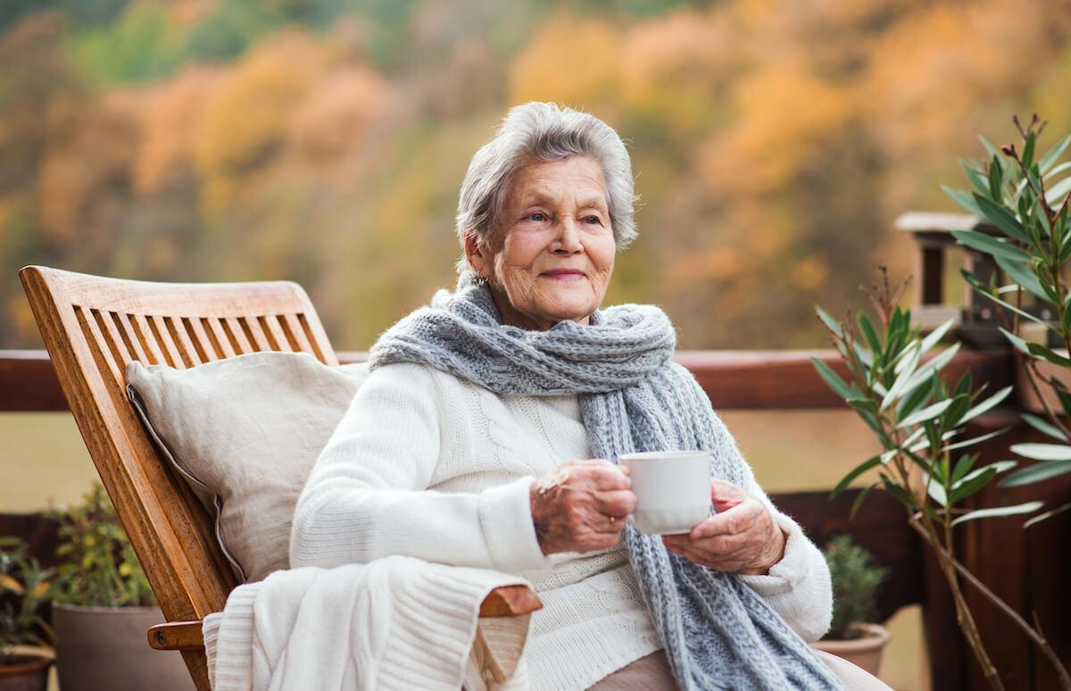 Senior woman enjoying coffee on porch_signs of dementia beyond memory loss