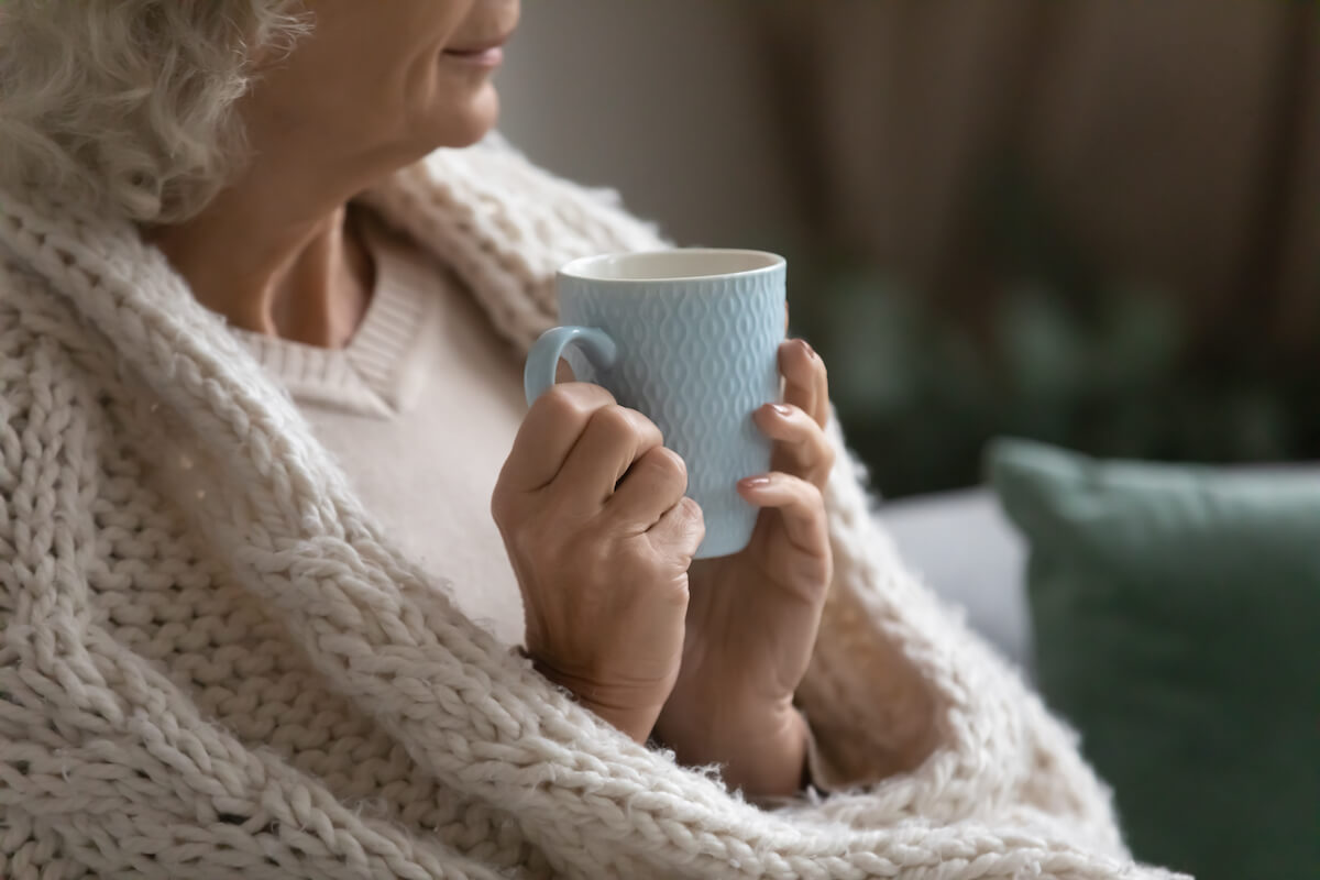 Older Woman Drinking Tea_Staying Healthy During Cold and Flu Season